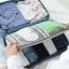กระเป๋าจัดระเบียบ Travel Luggage Organizer เสียบที่จับของกระเป๋าเดินทางได้ มีช่องใส่สองชั้นกั้นด้วยช่องตาข่าย ผลิตจากโพลีเอสเตอร์กันน้ำ thumbnail 5