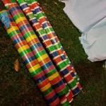ผ้ากระสอบพลาสติก ผ้าฟาง ลายริ้ว 4สี ลายธงชาติ สายรุ้ง (52สี่สีเคลือบ 1หน้า หนาพิเศษ) หลาละ 25 บาท