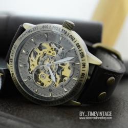 นาฬิกาข้อมือกลไกออโตเมติกดีไซต์วินเทจ หน้าปัดสีทองเหลืองขัด สายสีดำ