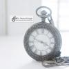ของที่ระลึกนาฬิกาคลาสสิคทรงกลมระบบถ่านสีดำด้างฝาหน้าคริสตัลหน้าปัดเลขโรมัน
