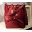 กระเป๋าสะพายหนังสีแดง แต่งโบว์ มีสายรูดที่ปากกระเป๋า thumbnail 1