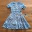 เดรสสั้นผ้าลูกไม้สีฟ้าสดตกแต่งระบายสไตล์เฟมินีน thumbnail 8