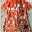 เดรสทรงปล่อย สีส้มทองพิมลายดอกไม้ ชุดนี้ใช้ผ้าซาตินผสมผ้าไหม thumbnail 5